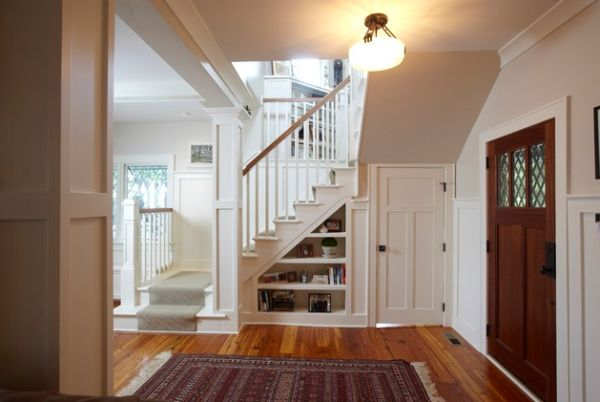 Ample shelf space under a modern staircase