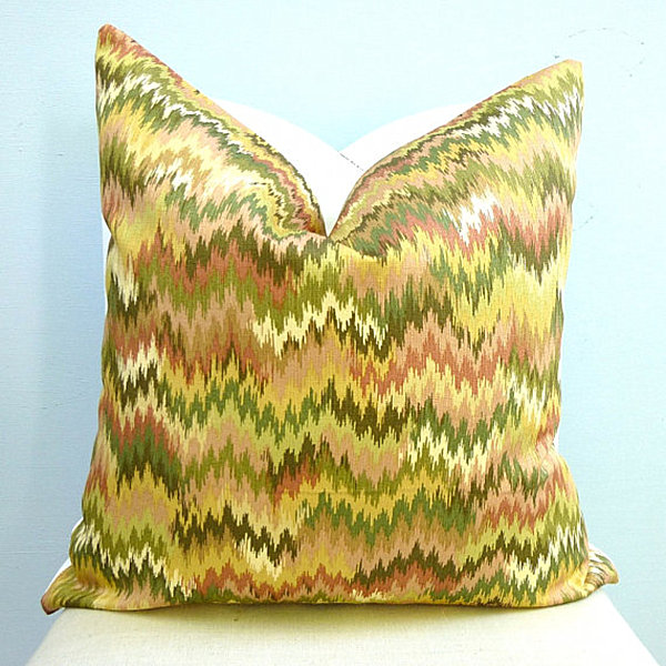 An ikat chevron pillow in citrus tones 5 Fabric Patterns That Are Back in Style