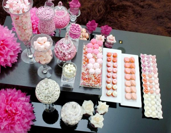 An ombre table setting in shades of rose
