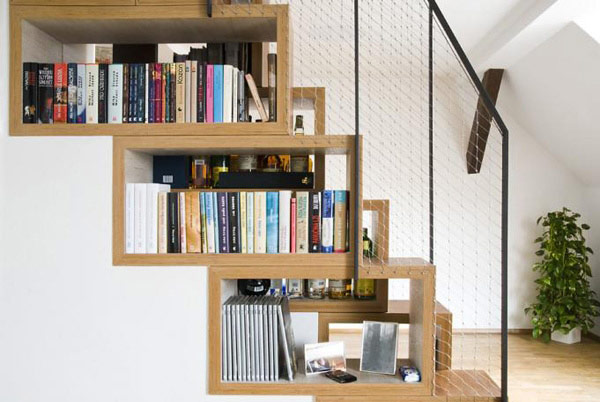 Beautiful book shelf that matches the design of the stairs