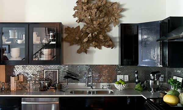 Black kitchen furniture and dark backsplash design
