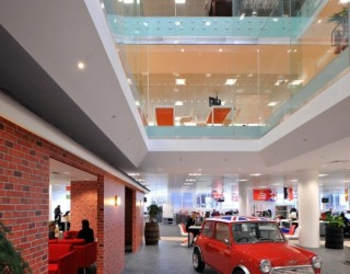 Morgan Lovell Paints the New Rackspace Office Red, With Flamboyant British-flavored Design!