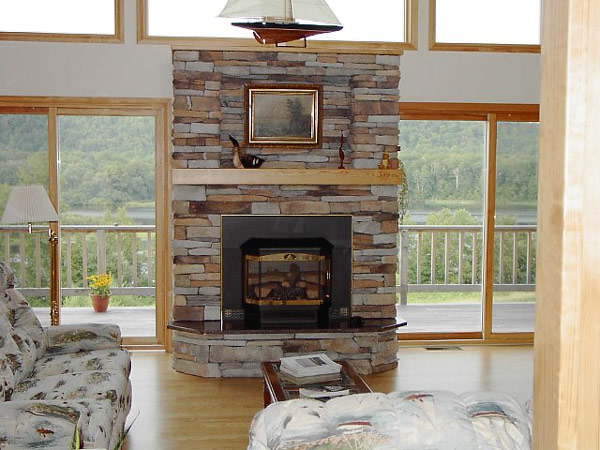 fireplace in lovely yellow stone view in gallery