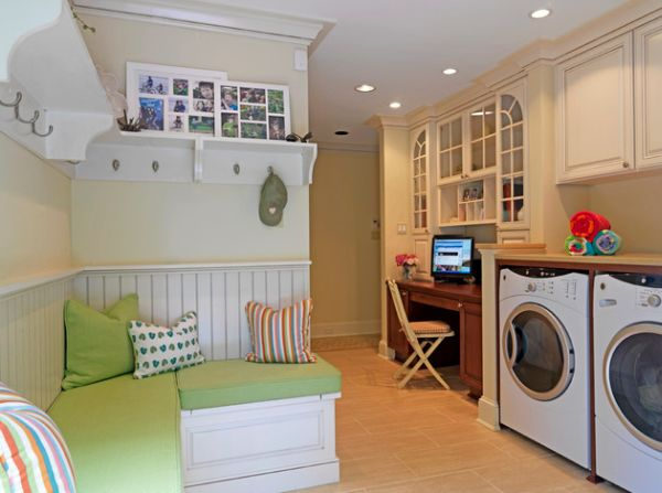Classy laundry room that also houses a daft work station