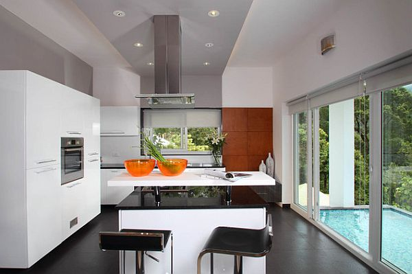 Contemporary modular island kitchen and conceived oven