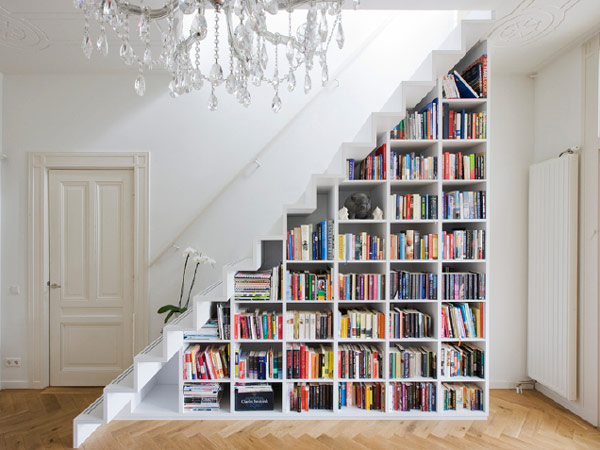 Contemporary staircase with minimalist book shelves in all-white