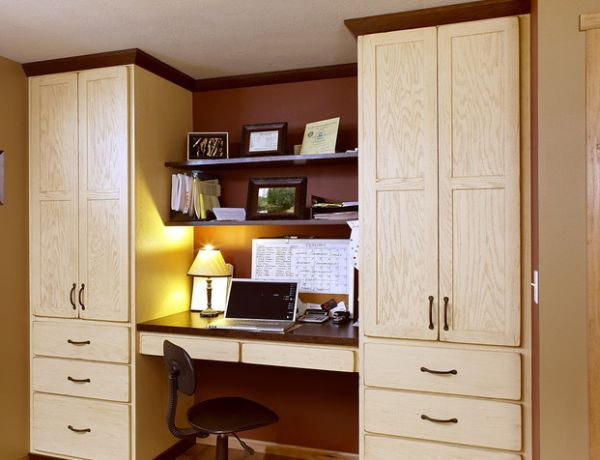 Cozy office space nestled between large red oak showplace cabinets 20 Home Office Design Ideas for Small Spaces