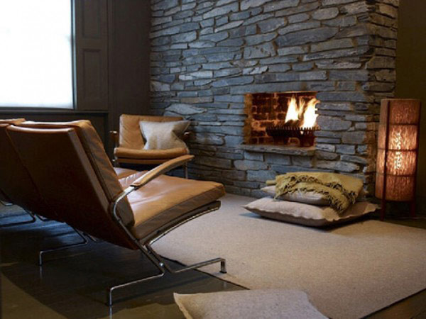 Dark stone fireplace offers an intimate setting
