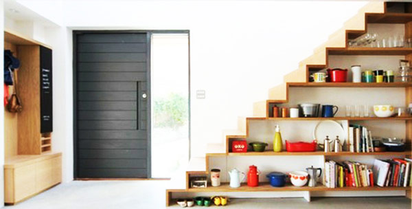 Fashionable shelves under stairs showcase well defined lines