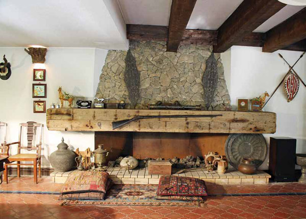 Fireplace laced with antiques and collectables  40 Stone Designs From Classic to Contemporary Spaces