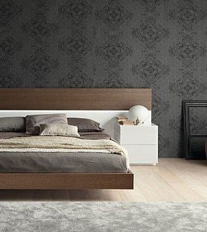 Modern bedroom with beautiful wallpaper and a stunning floating bed
