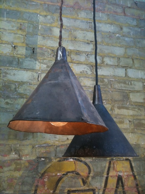 Pendant lamps from distressed Funnels.