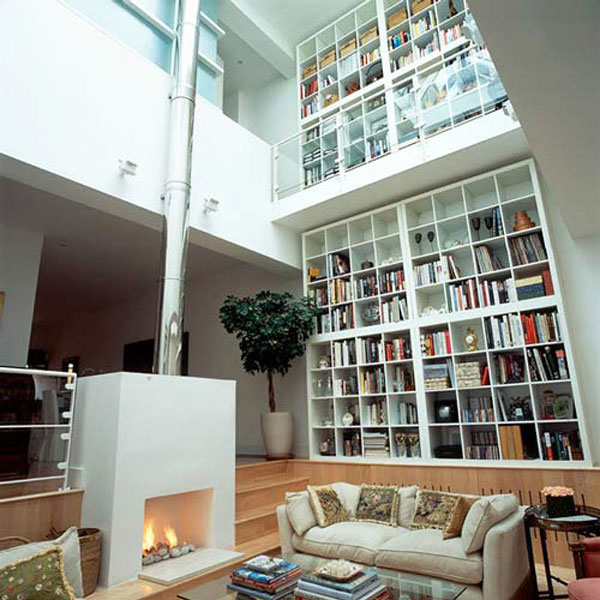 home library in single tone home library design sporting a giant tv