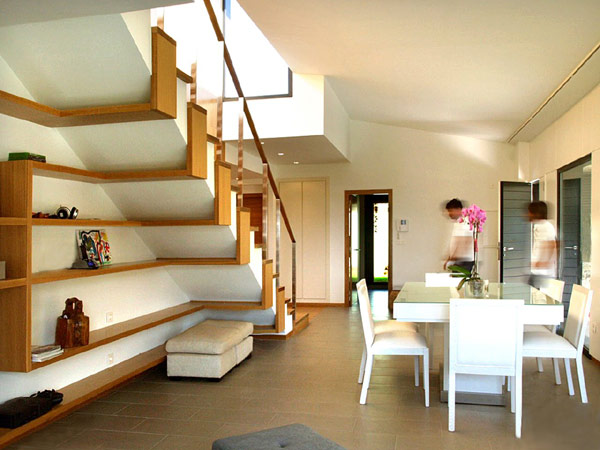 Gorgeous staircase with sleek and flowing shelves underneath