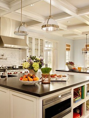 Large kitchen remodeling with white furniture and dark flooring