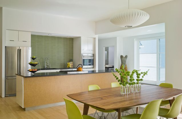 Light neutral kitchen with colorful finish materials