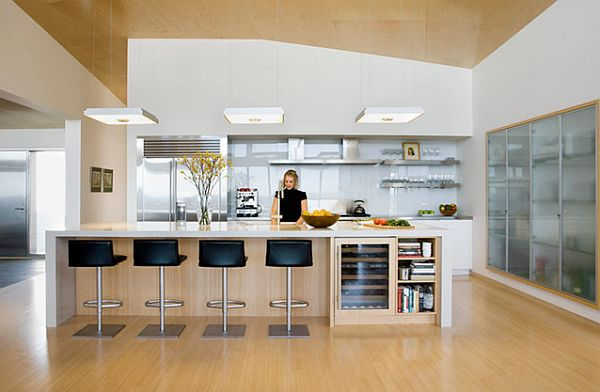 Modern kitchen with glass unit and light wood flooring