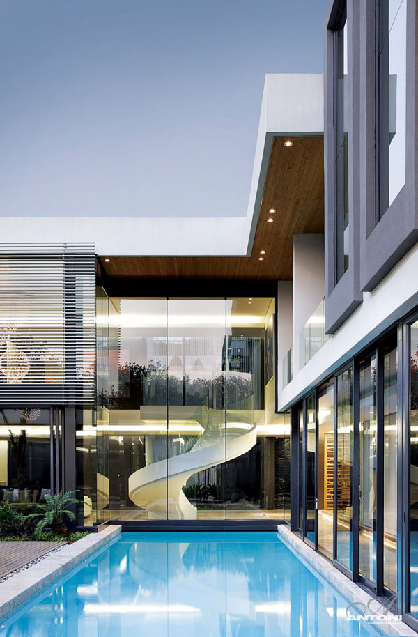Opulent modern home in Houghton pool view Sparkling Glass House in Johannesburg Twinkles with Glittering Contemporary Features