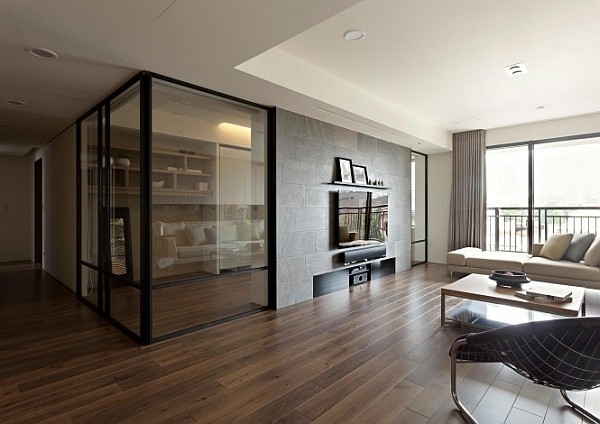 Retractable interior wall apartment Modern apartment with retractable glass walls for home office area