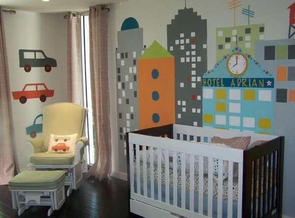 Skyline Blue crib set with a lovely mural as a backdrop