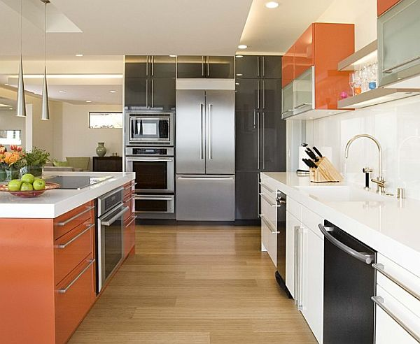 Slick and modern multi-colored cabinets in orange, white and black kitchen