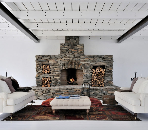Stone fireplace with storage space for logs