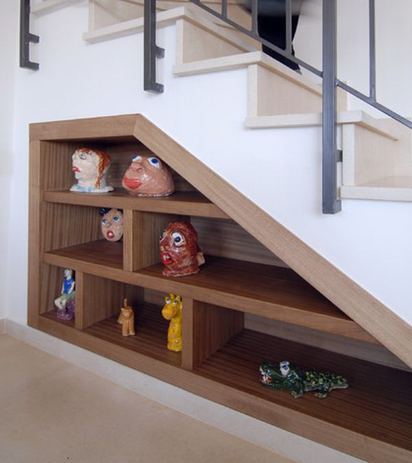 Storage space under stairs with eclectic decor