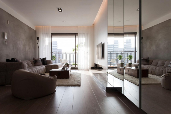 Taiwanese Contemporary Apartment living room with tall mirrors Modern Apartment in Taiwan Exudes Inspiring Form and Freshness