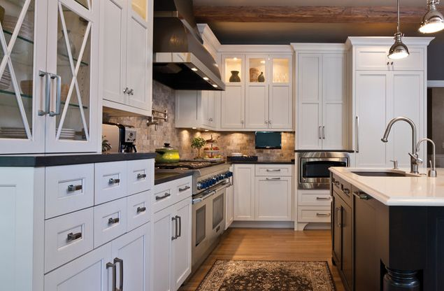 Traditional white painted cabinetry in kitchen remodel