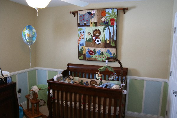 Traditional yet colorful sports baby crib and bedding set for the future football stars