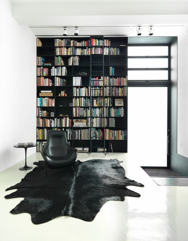 Ultra-sleek and chic all black shelf with white backdrop
