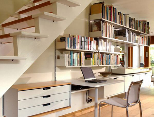 Utilize the room under the steps to stash away your books