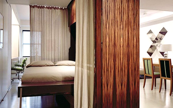Wall mounted curtains in a small apartment 10 Small Urban Apartment Decorating Ideas