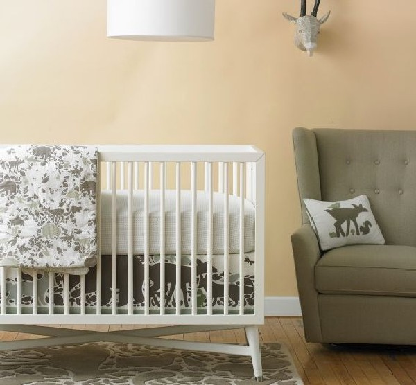 Woodland Tumble baby bedding in neutral shades ideal for boys with a wild spirit