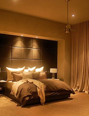 Breathtaking master bedroom design with beautiful lighting