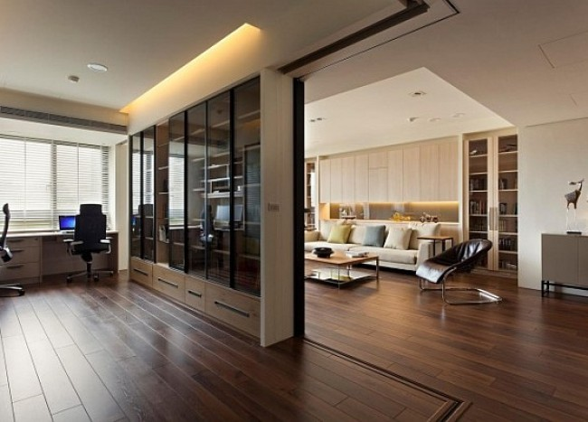 Modern apartment with retractable glass walls for home office area
