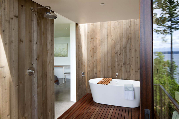 wooden bathroom with fancy bathtub