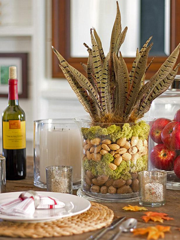 A Thankgsiving centerpiece made of nuts, feathers and moss