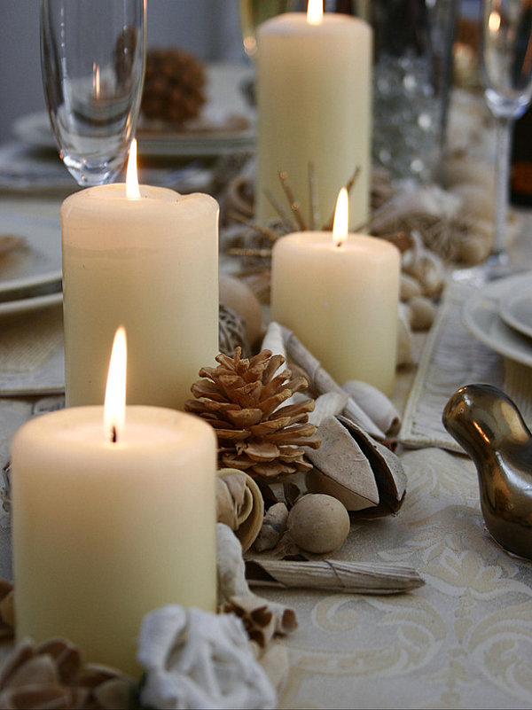 a thanksgiving centerpiece of seed pods candles and pine