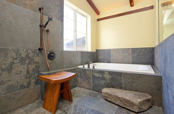 Classic Japanese bath with simple teak stool and daft use of stone