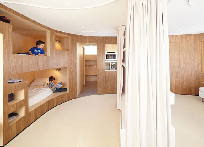 Cabin in the French Alps Gets Functional Curved Wooden Wall