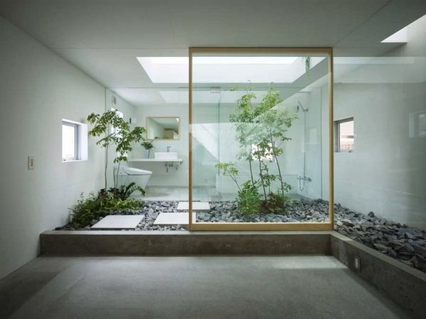Gorgeous zen styled Japanese bathroom design in glass and stone