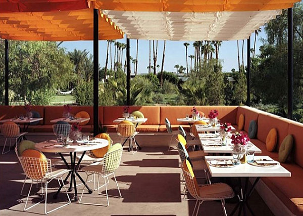 Metal-restaurant-chairs-in-a-space-designed-by-Jonathan-Adler