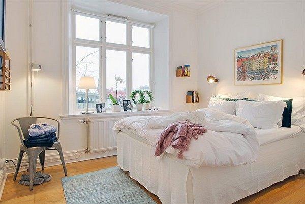 Scandinavian bedroom with a metal chair