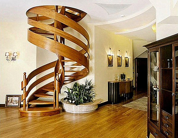 Wooden spiral staircase with ribbon-like railing