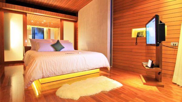 beachfront suite bedroom with wooden walls