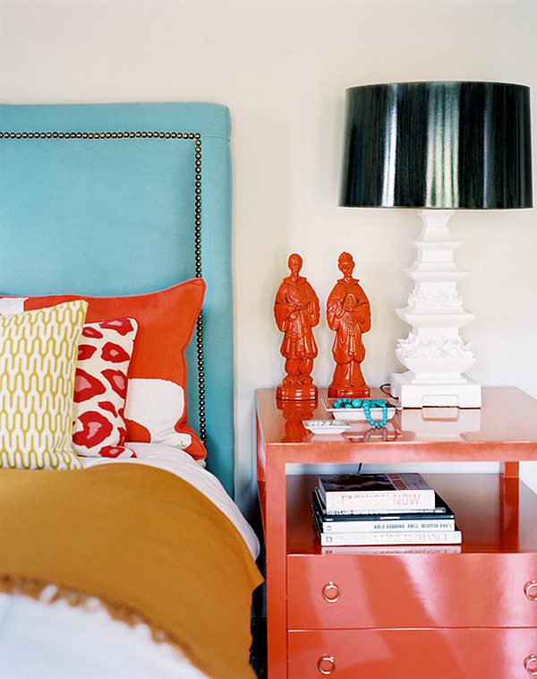 bedroom with turquoise headboard and red nightstand