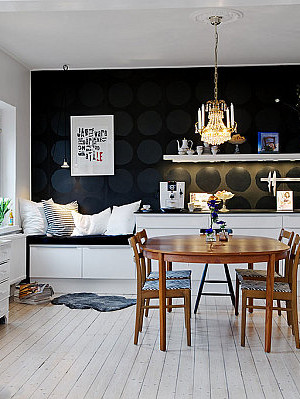 Black on black polka dots on the kitchen's accent wall