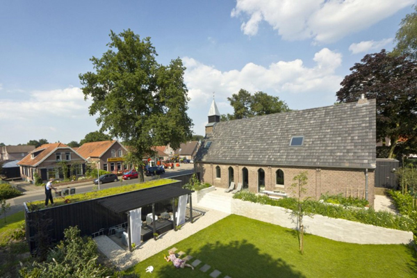 church and patio Dutch Church Transformation Into Beautiful and Playful Home