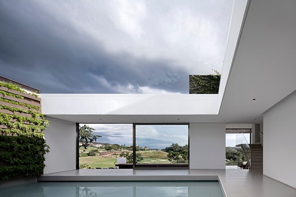 Casa hs prolific contemporary home sits proudly inside a for Case contemporanee progetti